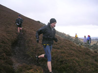 Val Brunton enjoying the heathery descent