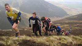 Chris leading a group up Scald Law